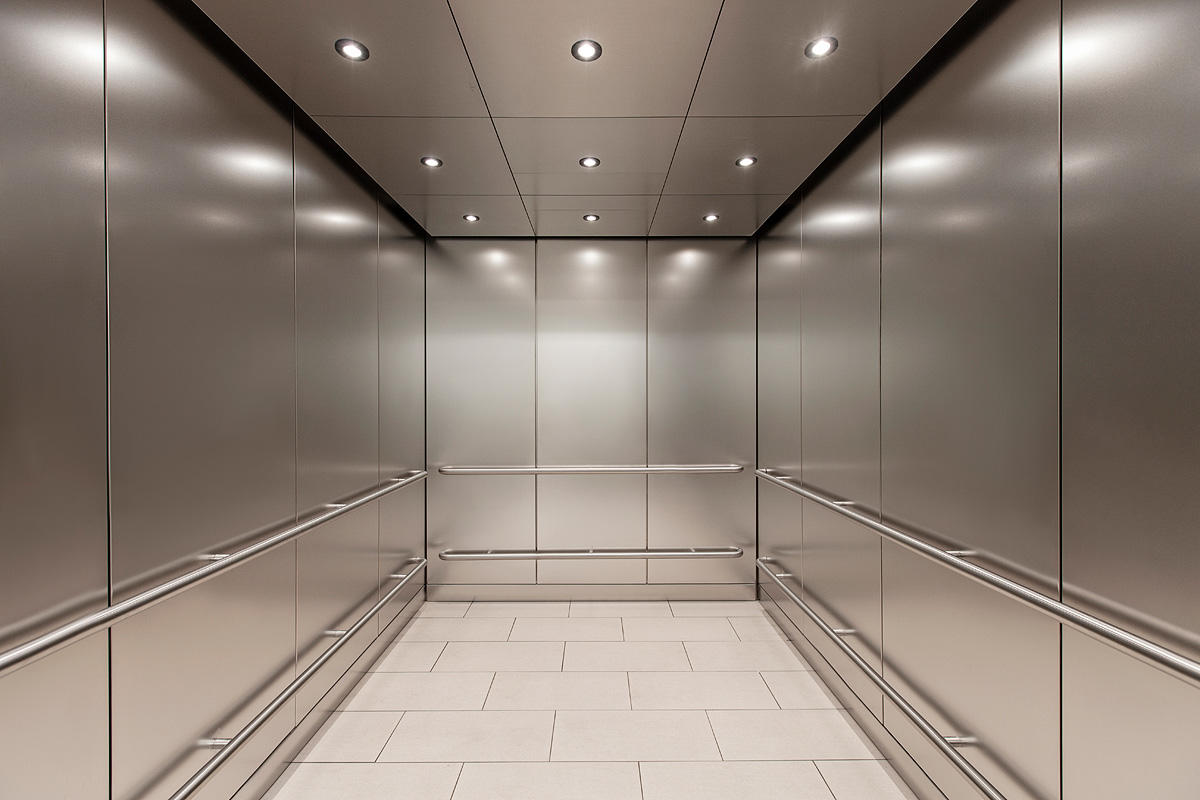 LEVELc-1000A Elevator Interior in Stainless Steel with Seastone finish
