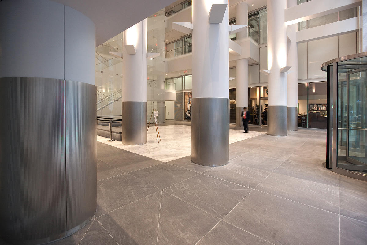 Columns in Stainless Steel with Seastone finish and Dallas pattern