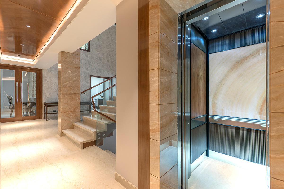 LEVELe-106 Elevator Interior with customized panel layout; Capture panels