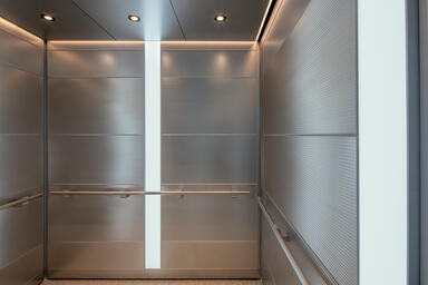 LEVELe-107 Elevator Interior with Capture panels in Stainless Steel with Sandsto